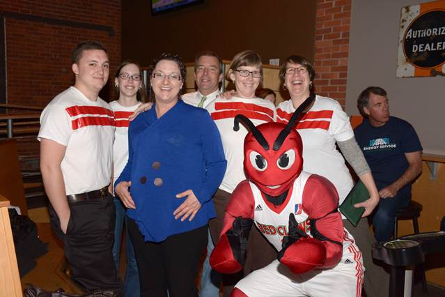 From left, of Bath Savings Institution: Dan Hallinan, Sarah Gagnon, Sarah Piper, Mike Celeste, Julie Wagoner, Theresa Hodge and Crusher of the Maine Red Claws