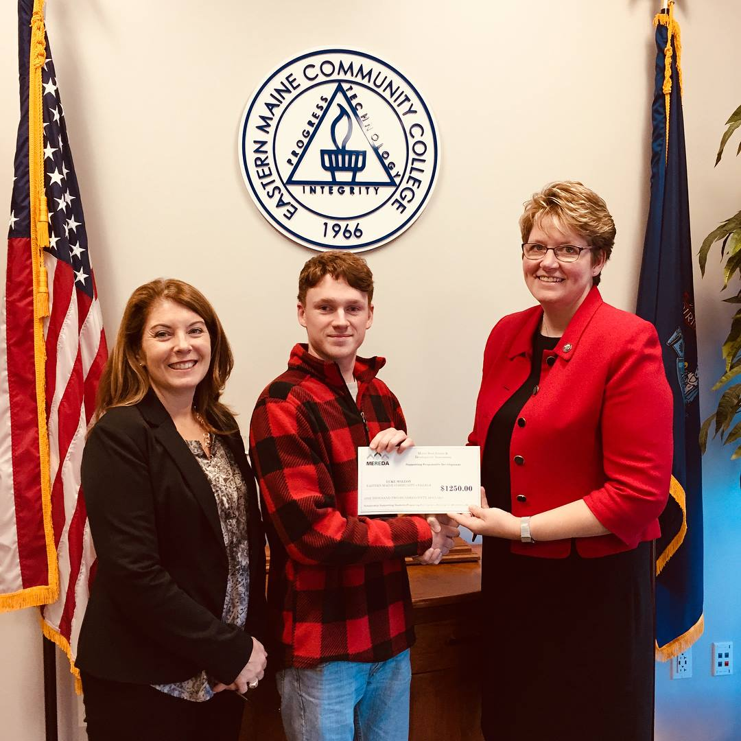 Jenn Khavari, Director of Advancement and Business Services at EMCC (left) and Bev Uhlenhake (right), Epstein Commercial Real Estate and MEREDA Board of Directors present a scholarship award to EMCC Student Luke Malloy